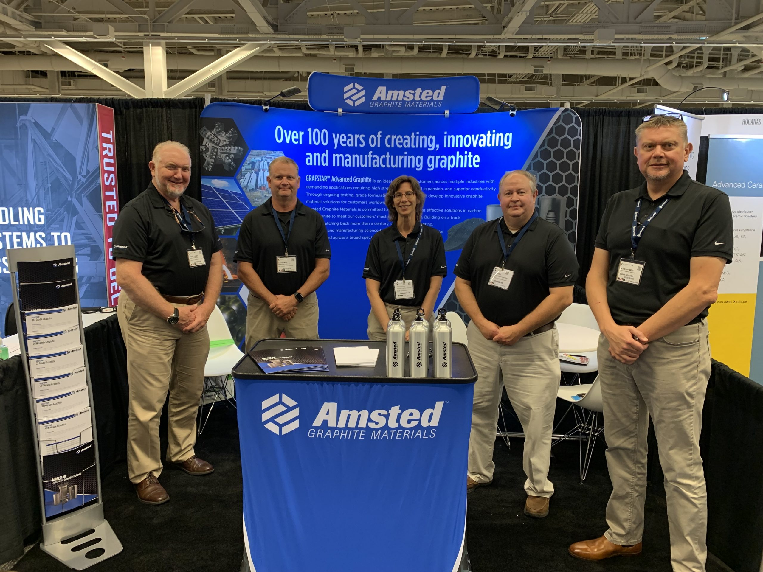 The Amsted Graphite Materials team poses at their booth at Ceramics Expo